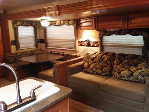travel trailer sofa and dining area